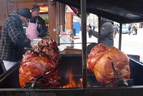 Hams roasting on spits