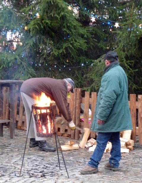 Keeping warm in Old Town Square, Český Krumlov