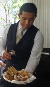 Waiter serving bread