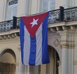 A large Cuban flag flies over Duval Street