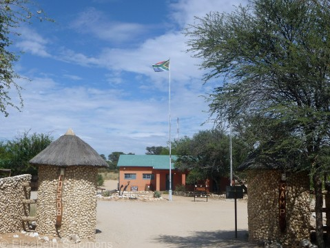 The entrance to a fenced campground on the South African side of the park